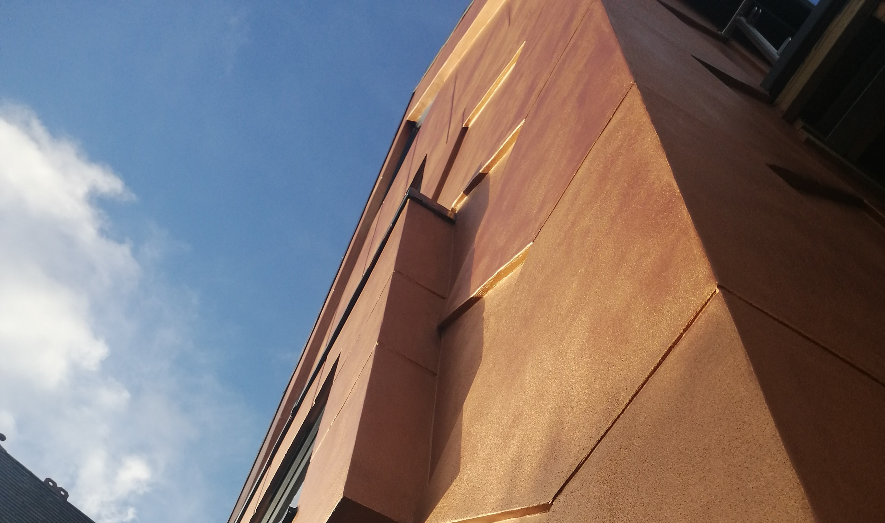 Project Feature: Baumit paint puts stunning bronze finish on gold-standard facade design